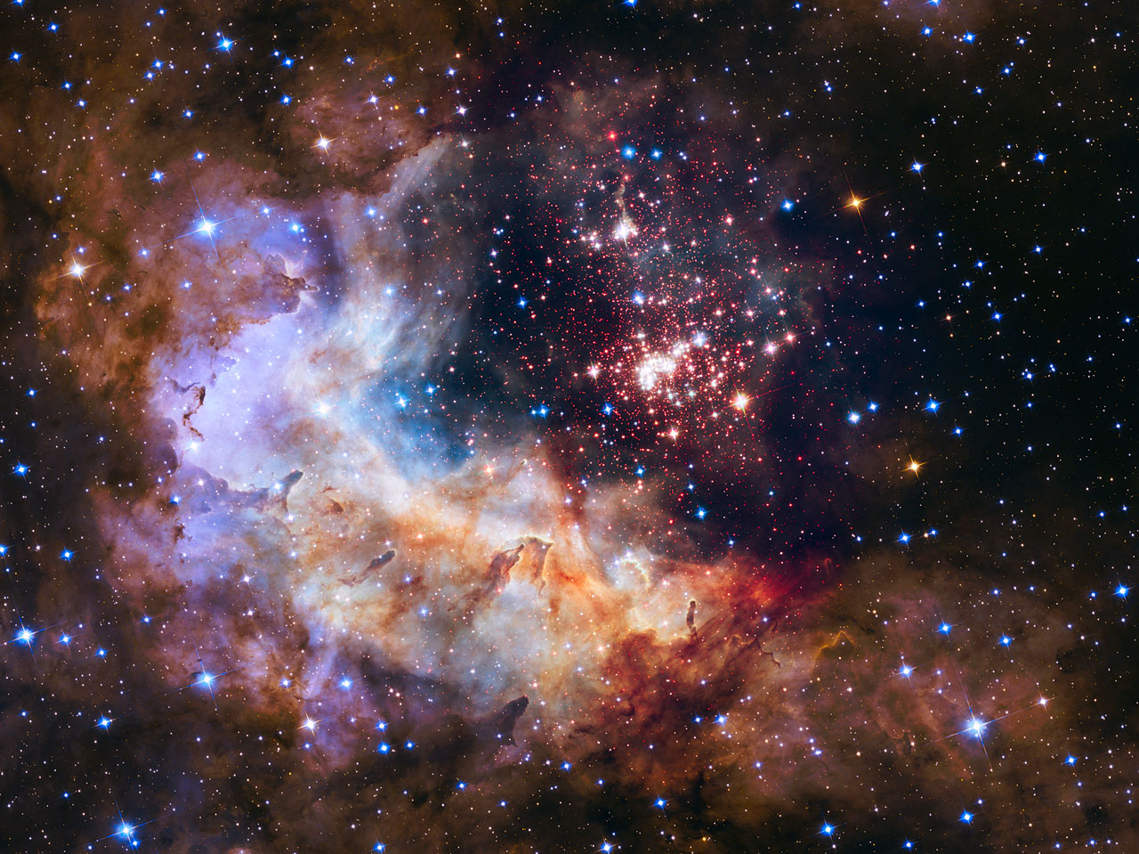 This NASA/ESA Hubble Space Telescope image of the cluster Westerlund 2 and its surroundings has been released to celebrate Hubble's 25th year in orbit and a quarter of a century of new discoveries, stunning images and outstanding science. The image's central region, containing the star cluster, blends visible-light data taken by the Advanced Camera for Surveys and near-infrared exposures taken by the Wide Field Camera 3. The surrounding region is composed of visible-light observations taken by the Advanced Camera for Surveys.